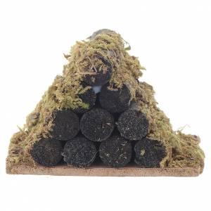 Muschio, licheni, piante, pavimentazioni: Catasta di legna con muschio presepe