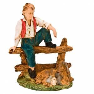 Figuras del Belén: Chico sentado valla con perro y cachorros 13 cm.