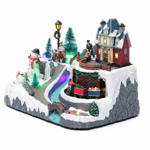 Christmas villages sets: Christmas village with a train, a snowman and music 20x25x20 cm