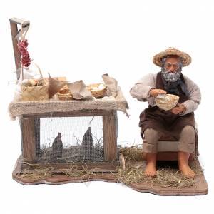 Neapolitan Nativity Scene: Egg seller sitting with movement 24 cm for Neapolitan nativity scene