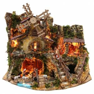 Stables and grottos: Illuminated nativity setting with stable, houses and mill 42x59x35cm