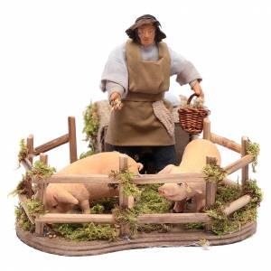Neapolitan Nativity Scene: Moving man feeding animals 12 cm