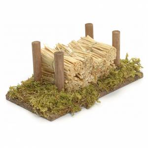 Nativity accessory, wood stack on moss with straw s2