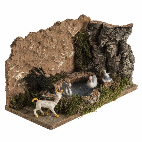 Nativity scene figurines, ducks in the lake and goat s2