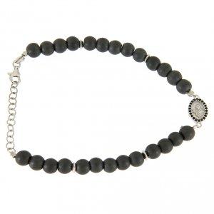 Silver bracelets: <br>Opaque grey stone bracelet in hematite, Saint Rita medal with black cubic zircons