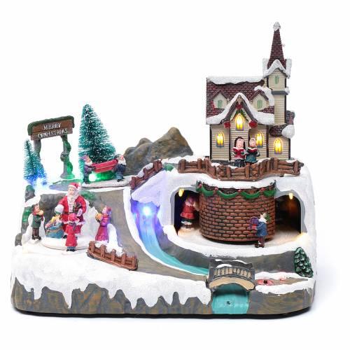 Paisaje de Navidad con música y Papá Noel y elfos en movimiento 20x25x20 cm s1