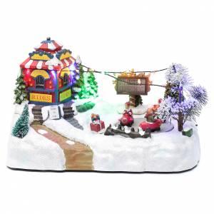 Pueblos navideños en miniatura: Paisaje de Navidad con parque en movimiento música y luces led 20x25x15 cm