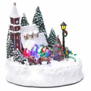 Paisaje de Navidad iluminado con niños en movimiento 20x20x15 cm s3