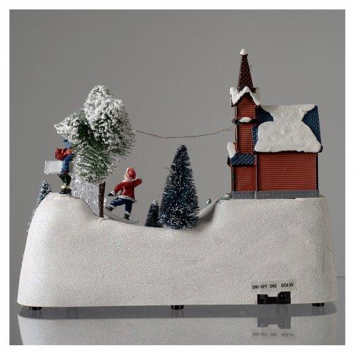 Scena natalizia musica chiesa pupazzo e albero in movimento 20x30x15 cm s5