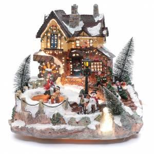 Villages de Noël miniatures: Village hivernal piste patinage mouvement et éclairage 25x30x30 cm