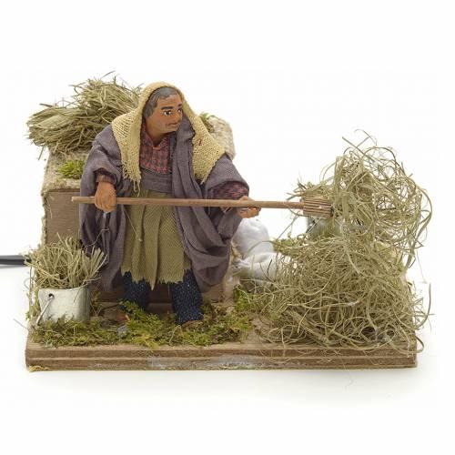 Animated Nativity scene figurine, peasant with hay 10 cm s1