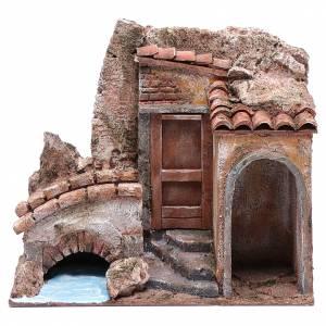 Ambientazioni, botteghe, case, pozzi: Casetta presepe con ponte su fiume 20x25x15 cm