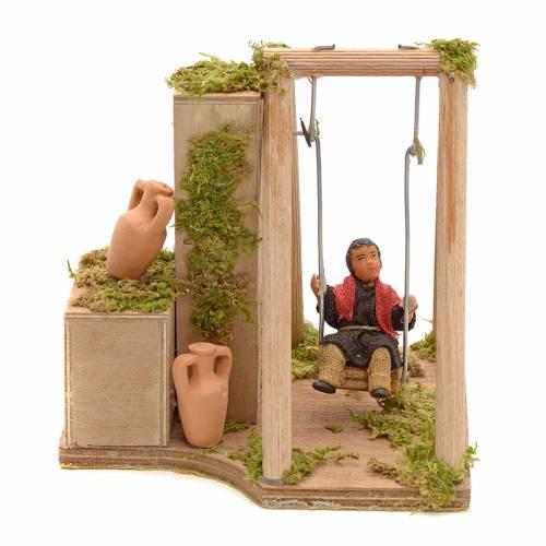 Crèche animé enfant qui joue à la balançoire 12 cm s1