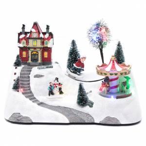 Pueblos navideños en miniatura: Escena navideña musical con carrusel y patinador en movimiento 20x30x15 cm