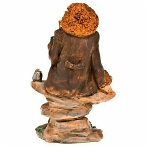 Krippenfiguren: Klein Engelkopf aus Holz mit goldenen Flügel