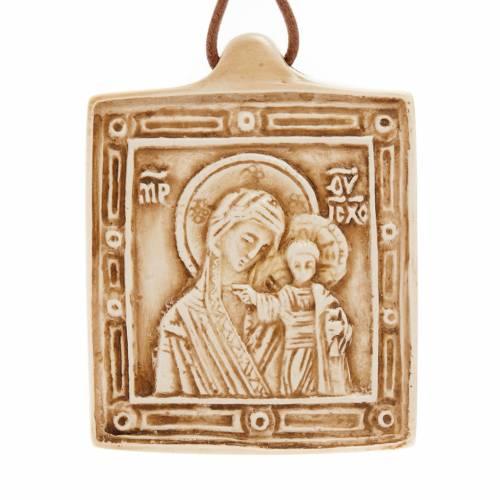 Medalla de piedra de la Virgen con el Niño Belén s1
