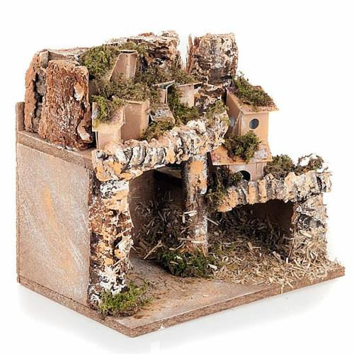 Nativity scene setting with houses and grotto s3