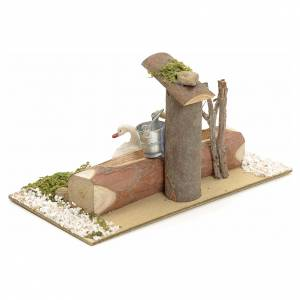 Nativity setting, fountain in the log s3