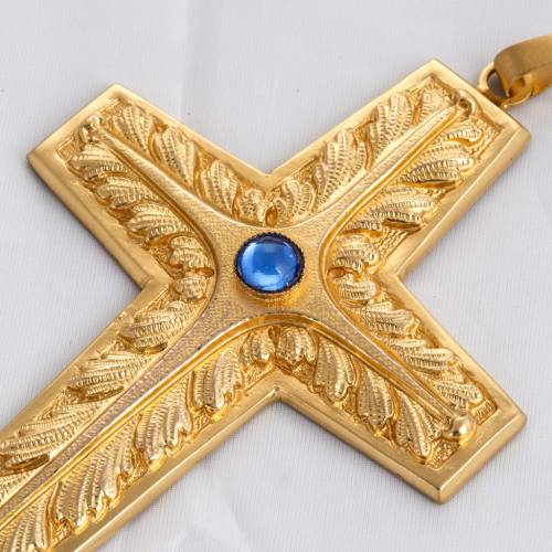 Pectoral cross in chiselled gold-plated copper with blue stone s2