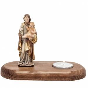 Saint Joseph with votive candle s1