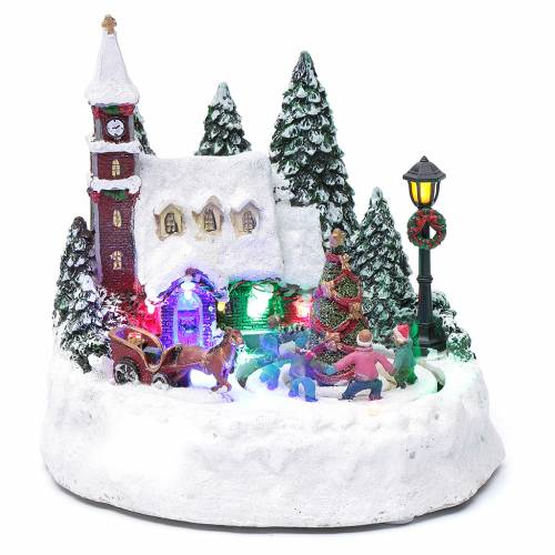 Villaggio di Natale illuminato bambini in movimento 20x20x15 cm s1