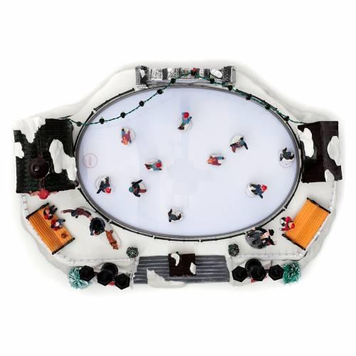 Villaggio natalizio animato luminoso musicale movimento pattinatori 18X40X27 cm s5