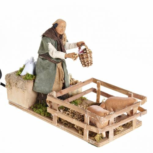 Animated Nativity scene figurine, man feeding pigs 14cm s1