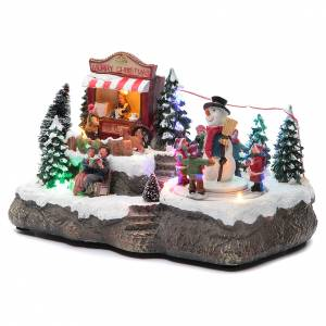Christmas villages sets: Christmas village with Ring a Ring-o' roses game and snowman  25x15x15 cm
