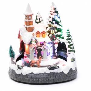 Aldea navideña iluminada musical movimiento carruajes 20x19x18 cm s1