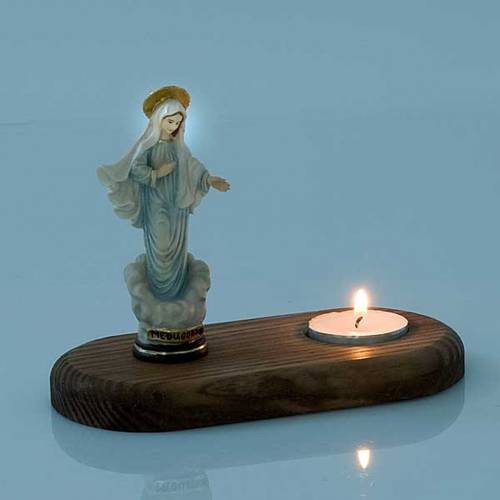 Madonna of Medjugorje with votive candle s3