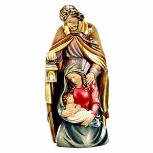 Sacra Famiglia in legno dipinta con colori accesi s1