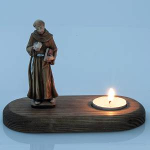 Saint Francis of Assisi with votive candle s2