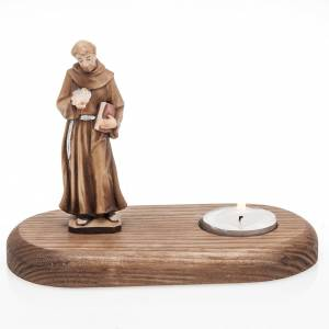 Saint Francis of Assisi with votive candle s1