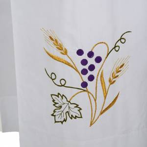 White alb in cotton with grapes and ears of wheat s2