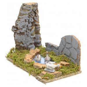 Nativity scene figurines, geese in the fake pond s2