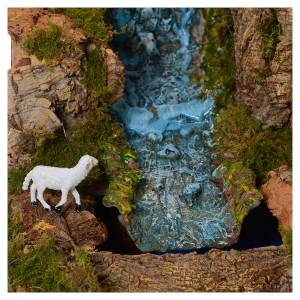 Stables and grottos: Nativity scenesetting70x115x70 cm with lights, nativity, moving shepherds and stream.