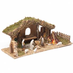Stables and grottos: Nativity setting, stable with fire and fence 25x56x21cm