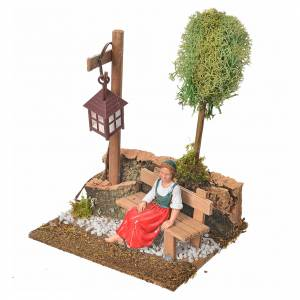 Nativity setting, woman sitting on bench with lamp s2