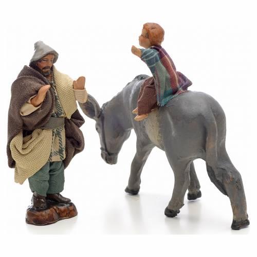 Neapolitan Nativity figurine, child on donkey with shepherd, 8 c s2
