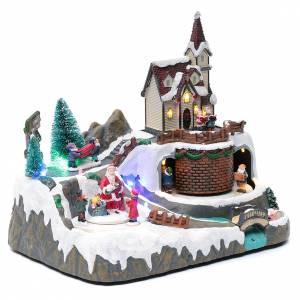 Paisaje de Navidad con música y Papá Noel y elfos en movimiento 20x25x20 cm s3