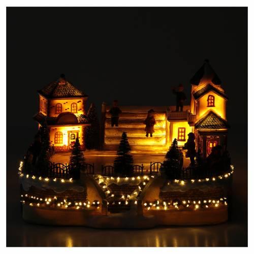 Pattinatori villaggio natalizio 20x20x20 luci, musica s5