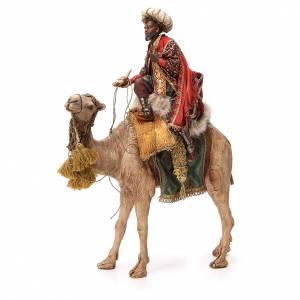 Roi Mage noir au turban sur chameau 18cm Tripi s1