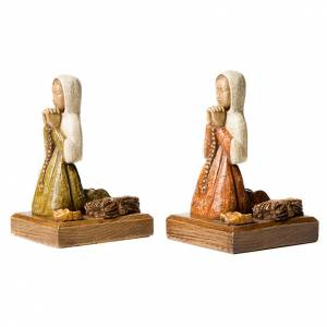 Stone statues: The Annunciation- white
