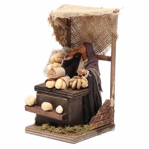 Venditrice di pane con banco 12 cm movimento presepe s2