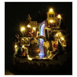 Villaggio di Natale con ruscello di fibra e musica 25x25x17 cm s4