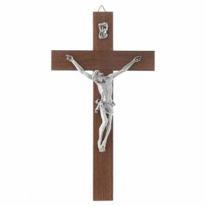 Wooden crucifixes: Wooden crucifix and metal body of Christ