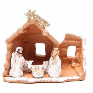 Terracotta Nativity Scene figurines from Deruta: Nativity in painted terracotta and snow 15x16x9cm