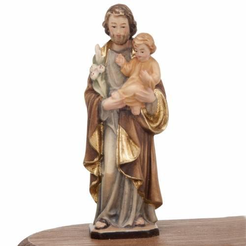 Saint Joseph with votive candle s3