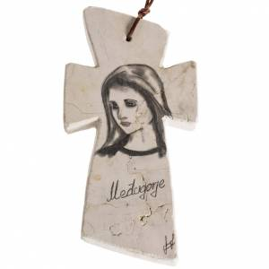 Crosses and magnets: Stone cross with face of Mary