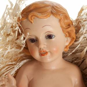Baby Jesus figurines: Baby Jesus figurine in pvc laying on straw, various sizes